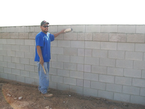 "6"" wide interlock block wall with splitface accent course in Phoenix Arizona"