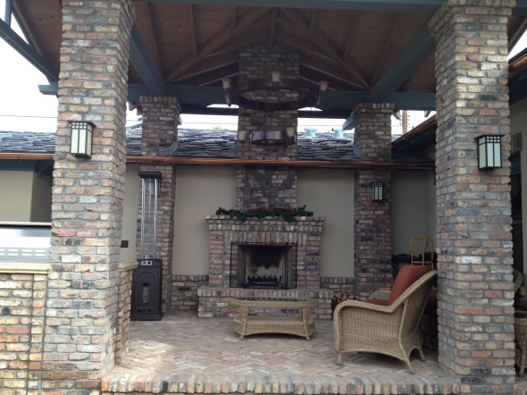 This is a Custom Fireplace with Herringbone pattern firebox that we built for a happy customer in Tucson Arizona